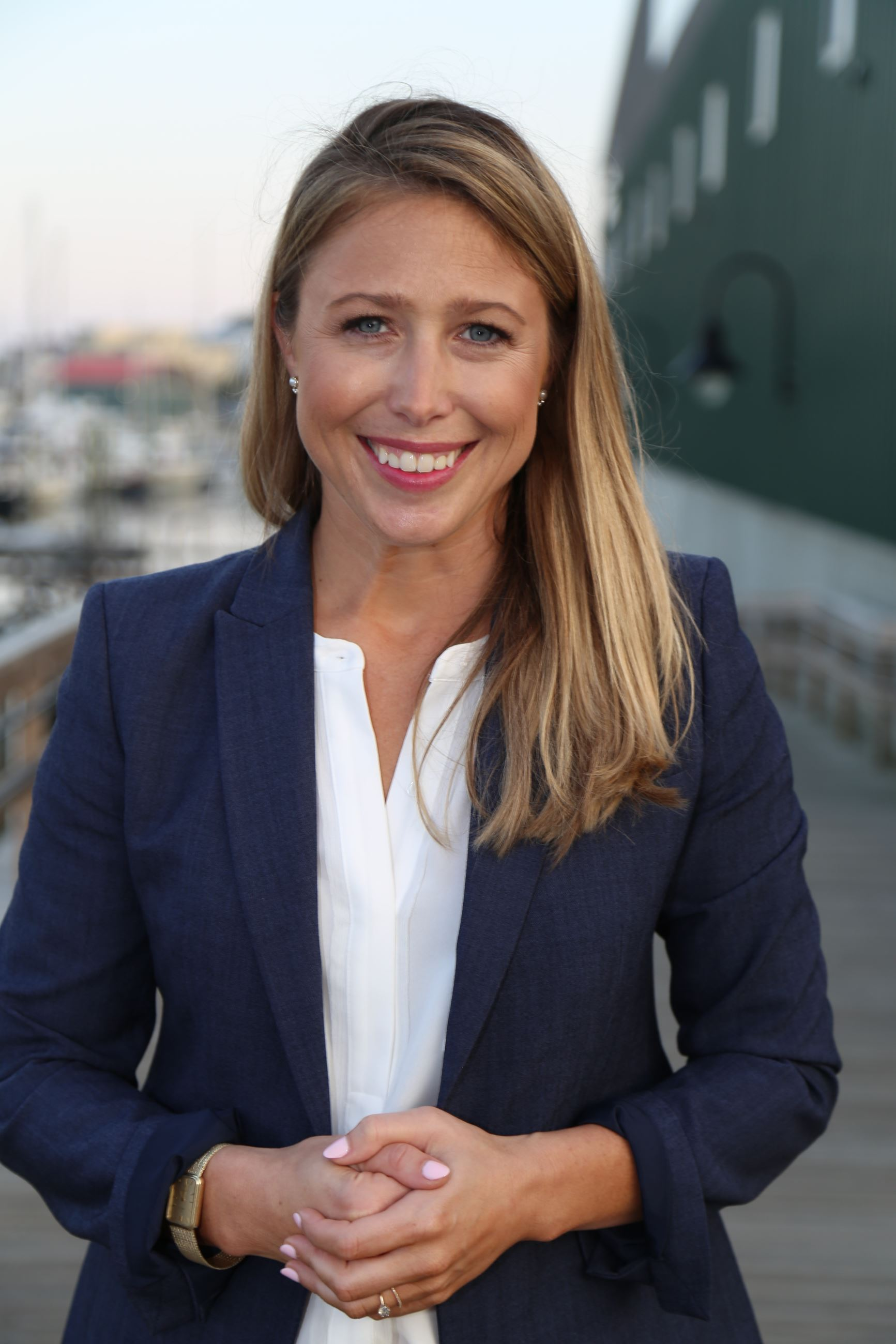 New City Manager Erin Herbig head shot, smiling at Belfast Harbor Walk.