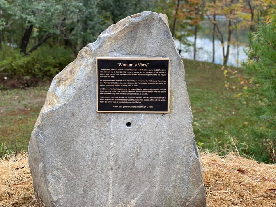 Dedication Stone for Joseph Slocum overlooking the water on the Rail Trail