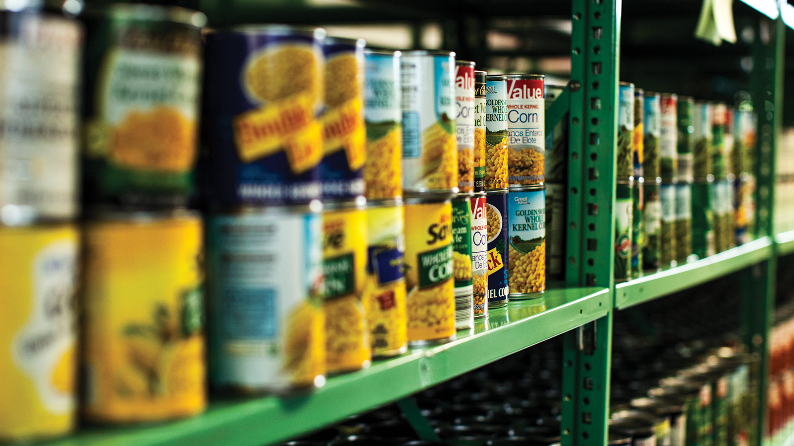 food pantry shelves stacked with canned food